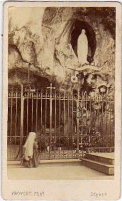 Antique photo or postcard showing St. Bernadette at the Lourdes grotto before she left Lourdes to enter Religious life